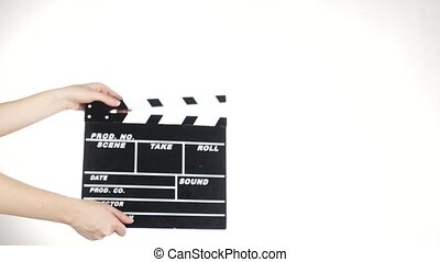 Person uses movie production clapper board, on white