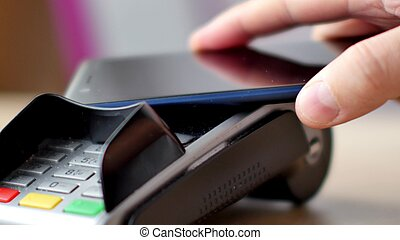 Person using contactless payment with smartphone. Mobile...