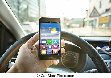 Person Using Mobile Phone While Driving