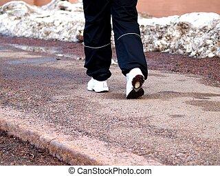 Person walking on the side walk