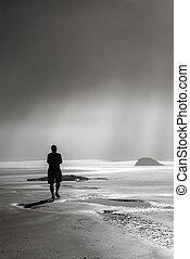Person walking toward sunbeams