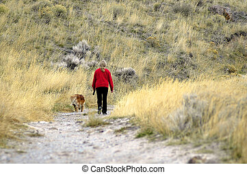 Person walking with dog - One person walking along trail...