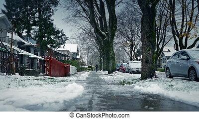 Person Walks On Sidewalk In The Snow