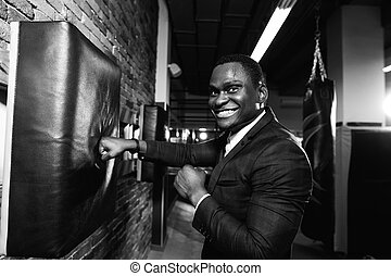 person wearing business suit and boxing gloves. - Stock...