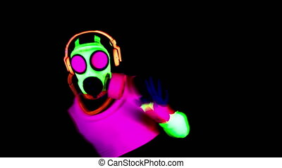 Person wearing protective gas mask during pandemic dancing in nightclub