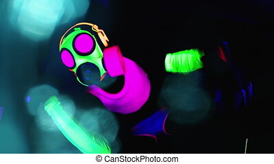 Person wearing gas mask raving in club - Person wearing ...