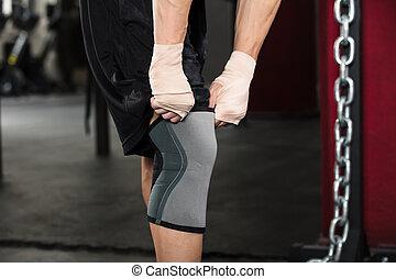 Person Wearing Knee Bandage