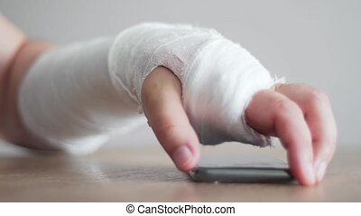 Person with a fracture is trying to take the phone to answer...