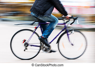 person with a racing bicycle in motion blur - picture of a...