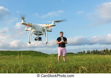 Person with Drone in Field