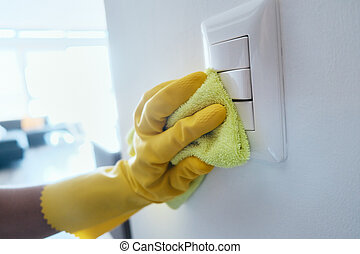 Person With Gloves Disinfecting Light Switches Using ...