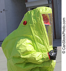 person with protective suit to work in presence of asbestos...