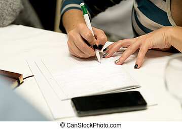Person writing in notepad