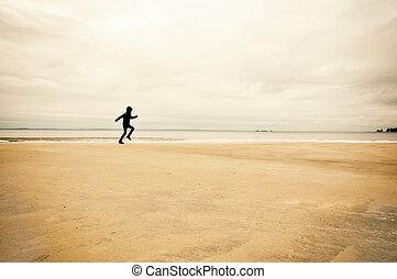 persona correndo, su, spiaggia