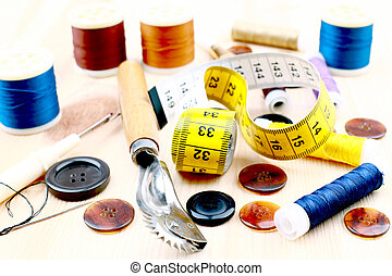 various type of sewing items on wood background