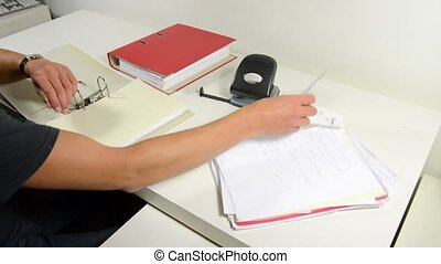 Personal Administration - Man, sitting behind his desk at...
