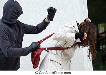 A personal assault on a passer-by with a red bag