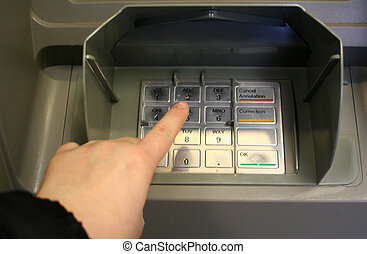personal banking - pressing personal code at ATM machine...