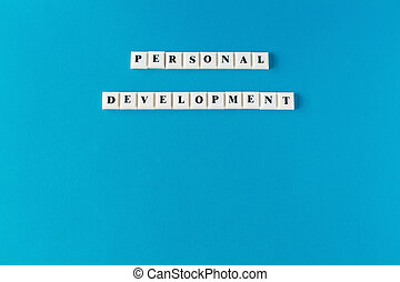 Personal development. Isolated text written on blue background