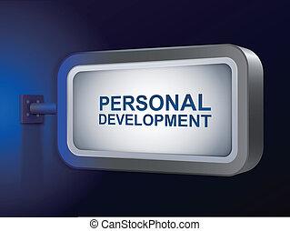 personal development words on billboard over blue background