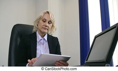 Personal Electronics - Low angle of mature businesswoman...
