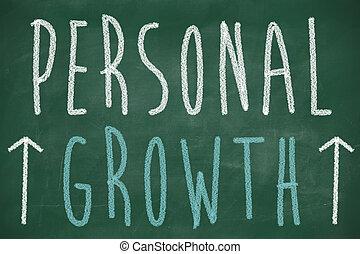Personal growth phrase handwritten on the chalkboard with ...