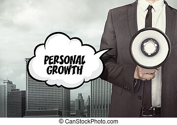 Personal Growth text on speech bubble with businessman