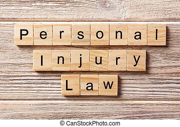 personal injury law word written on wood block. personal injury law text on table, concept