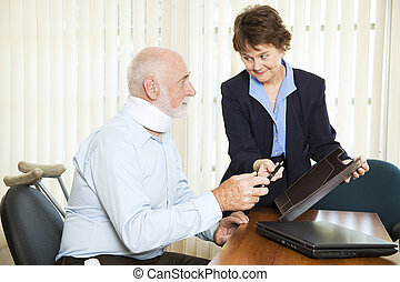 Injured man signing a settlement offer from the attorney.