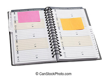 Personal organizer with adhesive note on white