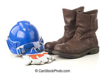 A set of protective equipment such as hard hat, safety glass, semi leather gloves and safety shoes isolated with white background