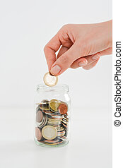 Personal savings concept illustrated with money in a jar