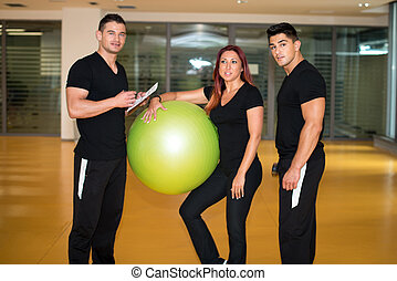 personal trainer at gym