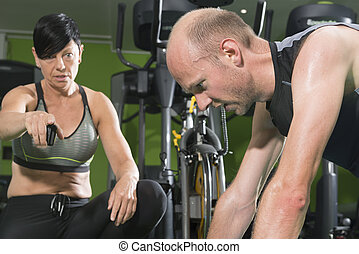 Personal Trainer Coaching Her Client in a Gym