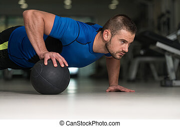 Pushups With Medicine Ball