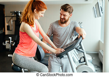 Personal trainer giving instructions