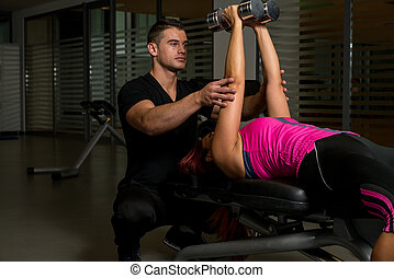 personal trainer in gym