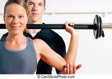 Personal Trainer in gym - Woman with her personal fitness ...