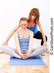 Personal Trainer - young fitness woman stretching With...