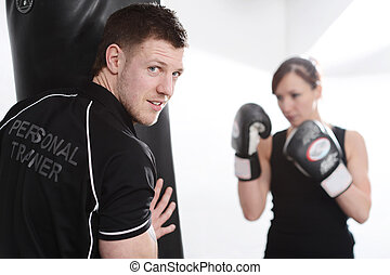 Personal trainer - Woman working out with personal trainer...