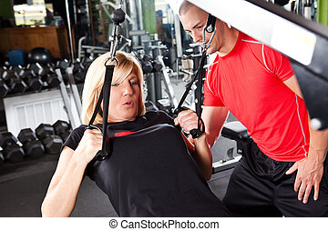 Personal training - A shot of a male personal trainer ...