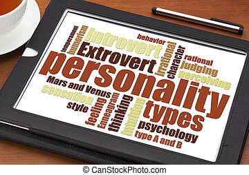 personality types word cloud on a digital tablet with a cup...
