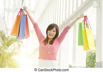 persone asiatiche, shopping
