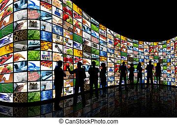 persone, guardando, parete, di, schermi