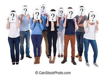 personengruppe, frage, verschieden, besitz, zeichen & schilder
