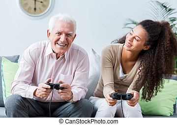 personne agee, console, jouer