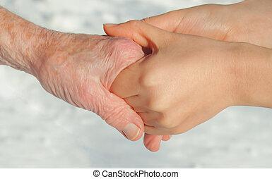 personne agee, jeune, tenant mains