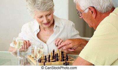 personne agee, table, jeu, couple, séance