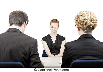 Personnel officers interviewing a candidate - Rear view of a...
