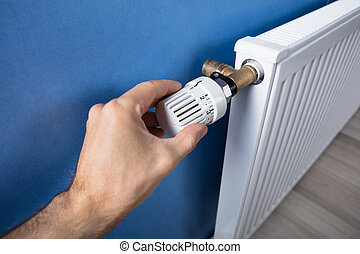 Hand Adjusting Temperature On Thermostat